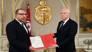 رئيس وزراء تونس يعلن استعداده تسليم السلطة